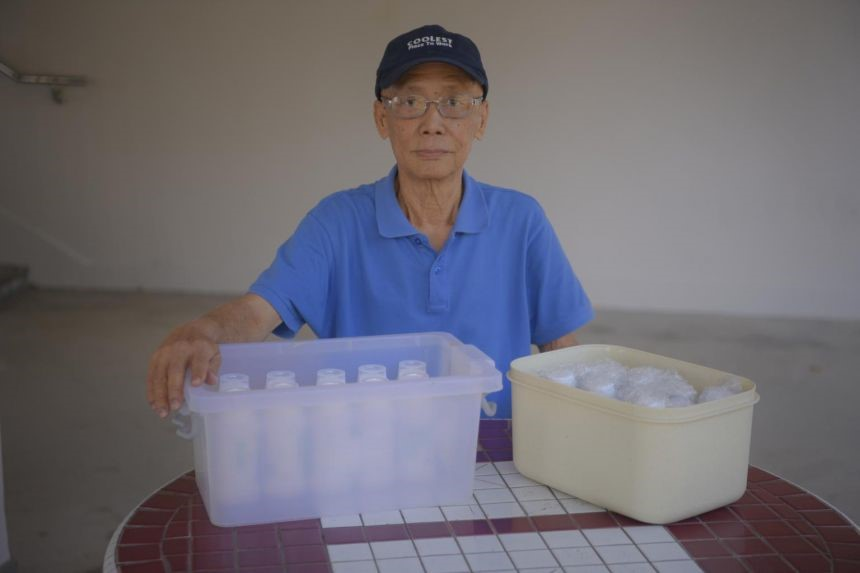 ​Retiree Lee Meow Khin with his medicine delivered to his home.ST PHOTO MARK CHEONG