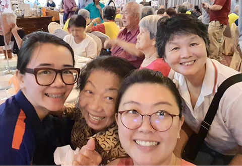​Bright smiles on everyone's faces at the charity lunch, elderly and NHCS nurse volunteers alike!